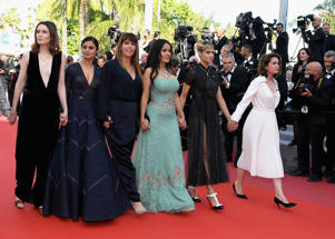 Female filmmakers on the red carpet in protest of the lack of female filmmakers honored throughout the history of the festival at the screening of 'Girls Of The Sun (Les Filles Du Soleil)' during the 71st annual Cannes Film Festival at Palais des Festivals on May 12, 2018 in Cannes, France.