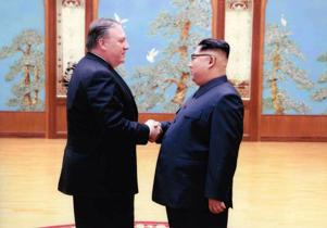 CIA director Mike Pompeo (L) shakes hands with North Korean leader Kim Jong Un in this undated image in Pyongyang, North Korea.