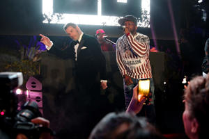 CAP D'ANTIBES, FRANCE - MAY 15: John Travolta and Singer 50 Cent ( Curtis James Jackson III ) on stage during the party in Honour of John Travolta's receipt of the Inaugural Variety Cinema Icon Award during the 71st annual Cannes Film Festival at Hotel du Cap-Eden-Roc on May 15, 2018 in Cap d'Antibes, France. (Photo by Gisela Schober/Getty Images)