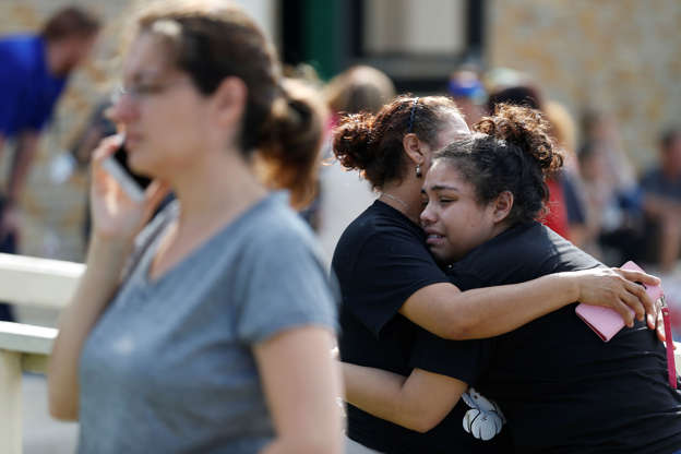 Slide 1 of 6: Santa Fe High School junior Guadalupe Sanchez, 16, cries in the arms of her mother, Elida Sanchez, after reuniting with her at a meeting point at a nearby Alamo Gym fitness center following a shooting at Santa Fe High School in Santa Fe, Texas, on Friday, May 18, 2018. (Michael Ciaglo/Houston Chronicle via AP)