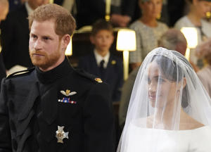 CAPTION: Britain's Prince Harry, Duke of Sussex (L) and US actress Meghan Markle (R) stand together at the altar in St George's Chapel, Windsor Castle, in Windsor, on May 19, 2018 during their wedding ceremony. (Photo by Dominic Lipinski / POOL / AFP) (Photo credit should read DOMINIC LIPINSKI/AFP/Getty Images)