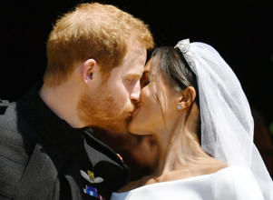 Prince Harry and Meghan Markle kiss on the steps of St George's Chapel in Windsor Castle after their wedding.