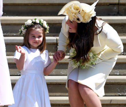Slide 1 of 30: Britain's Catherine, Duchess of Cambridge and her daughter Princess Charlotte leave St George's Chapel in Windsor Castle after the royal wedding ceremony of Prince Harry, Duke of Sussex and Meghan, Duchess of Sussex in Windsor, Britain, May 19, 2018. NEIL HALL/Pool via REUTERS
