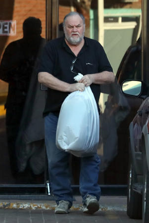 a man holding a fish: *EXCLUSIVE* Rosarito, MEXICO - Meghan Markle's father Tom runs errands in his home town of Rosarito, Mexico. The 73 year old was spotted carrying a packet of British tea and picking up his laundry. Pictured: Tom Markle BACKGRID USA 6 DECEMBER 2017 BYLINE MUST READ: NGRE / BACKGRID USA: +1 310 798 9111 / usasales@backgrid.com UK: +44 208 344 2007 / uksales@backgrid.com *UK Clients - Pictures Containing Children Please Pixelate Face Prior To Publication*