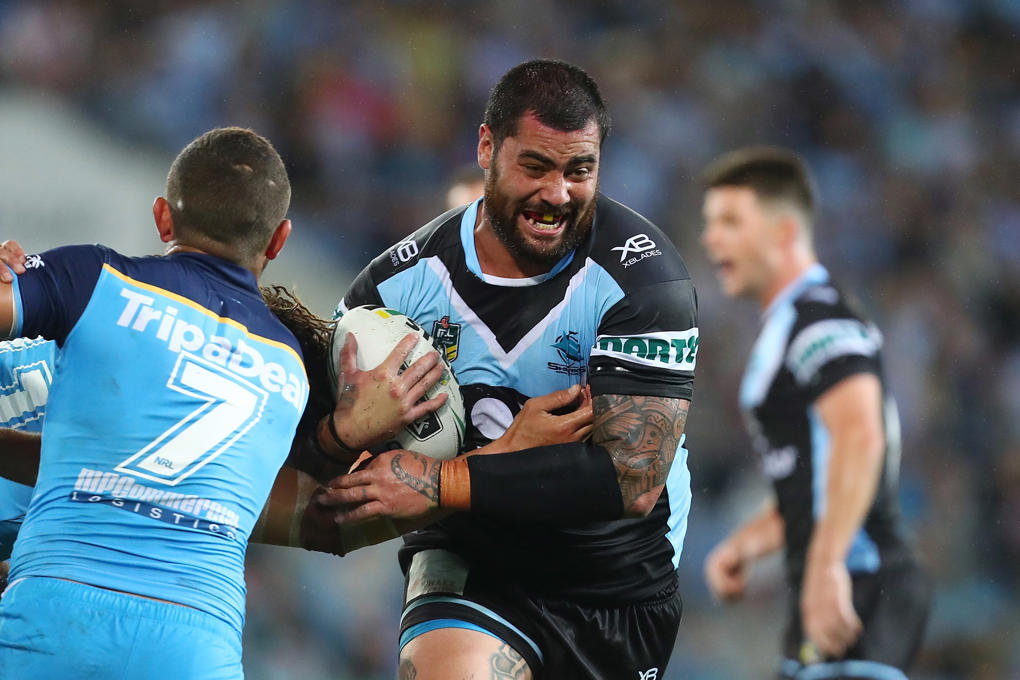 GOLD COAST, AUSTRALIA - APRIL 28:  Andrew Fifita of the Sharks is tackled during the round eight NRL match between the Gold Coast Titans and Cronulla Sharks at Cbus Super Stadium on April 28, 2018 in Gold Coast, Australia.  (Photo by Chris Hyde/Getty Images)