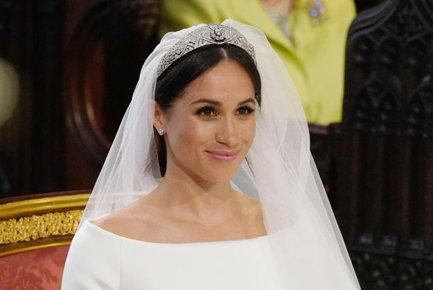 CAPTION: US fiancee of Britain's Prince Harry, Meghan Markle arrives at the High Altar for their wedding ceremony in St George's Chapel, Windsor Castle, in Windsor, on May 19, 2018. (Photo by Jonathan Brady / POOL / AFP) (Photo credit should read JONATHAN BRADY/AFP/Getty Images)