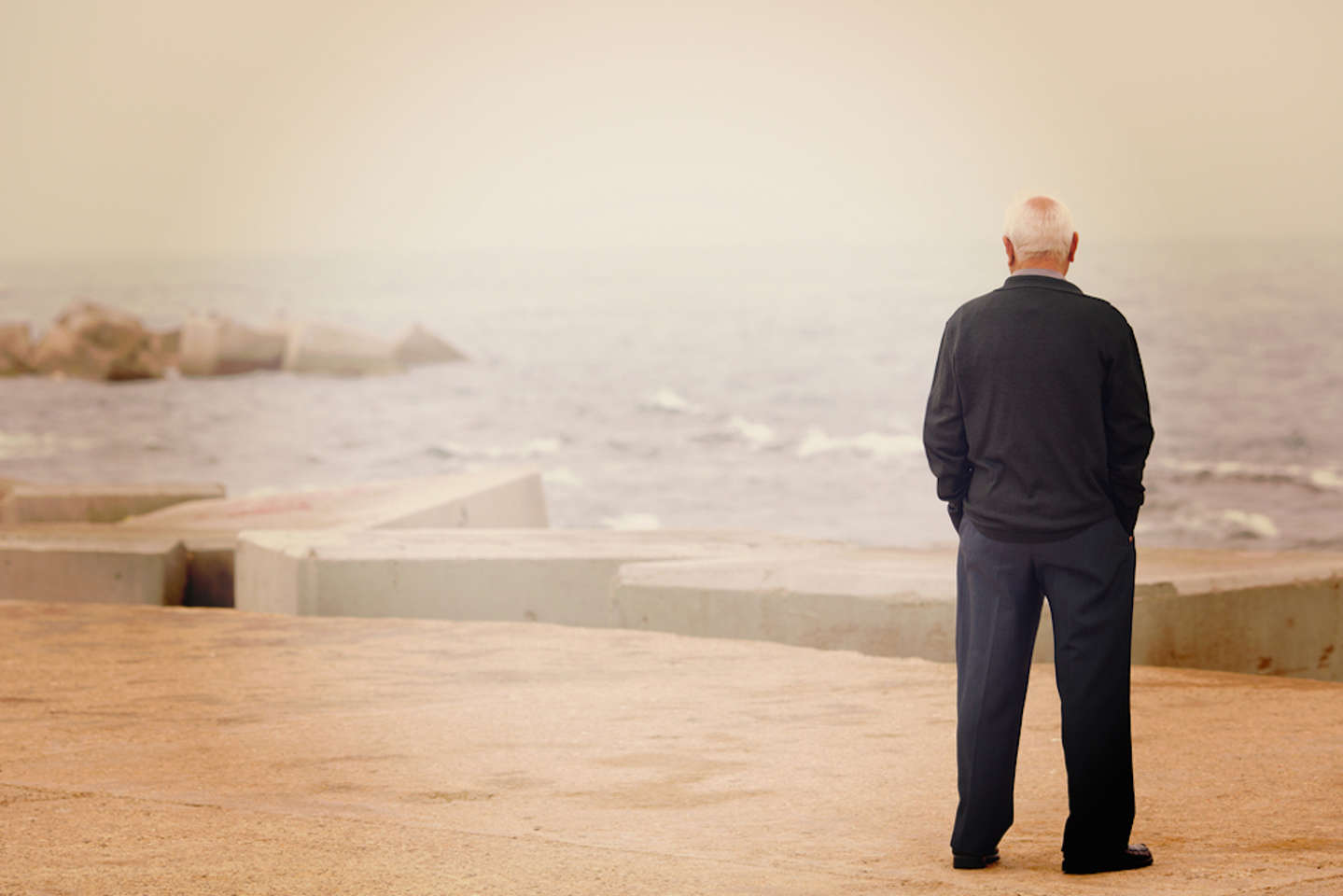 a man standing in front of a beach
