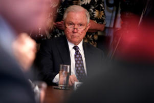 Attorney General Jeff Sessions listens to President Donald Trump speak during a roundtable on immigration policy in California, in the Cabinet Room of the White House, Wednesday, May 16, 2018, in Washington.