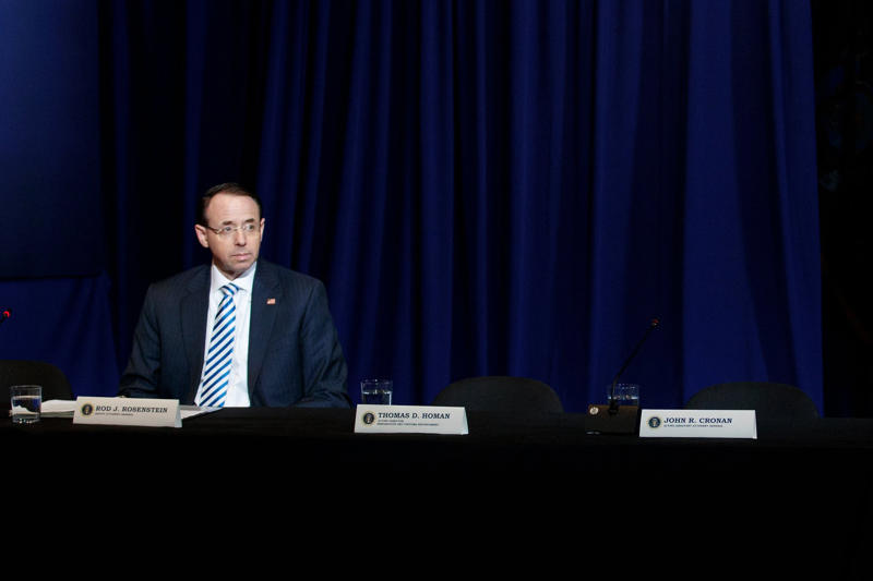 a man standing in front of a curtain: Rod J. Rosenstein, the deputy attorney general, oversees the special counsel's investigation.