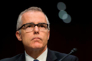 a man wearing a suit and glasses: Memos written by Andrew G. McCabe, the former acting F.B.I. director, highlight the conflicting roles that Mr. Rosenstein plays in the special counsel investigation.