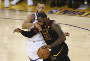 Cleveland Cavaliers forward LeBron James (23) drives against Golden State Warriors guard Stephen Curry during the second half of Game 1 of basketball's NBA Finals in Oakland, Calif., Thursday, May 31, 2018.
