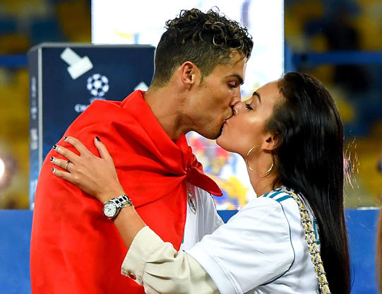 Slide 59 of 75: Cristiano Ronaldo of Real Madrid CF kisses hsi girlfriend Georgina Rodriguez as they celebrate his side victory following winning the UEFA Champions League final between Real Madrid and Liverpool on May 26, 2018 in Kiev, Ukraine.  (Photo by David Ramos/Getty Images)