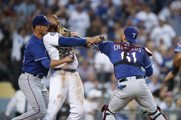 Slide 3 of 75: Texas Rangers starting pitcher Cole Hamels, left, restrains Los Angeles Dodgers' Matt Kemp as Kemp scuffles with Rangers catcher Robinson Chirinos during the third inning of a baseball game, Wednesday, June 13, 2018, in Los Angeles.