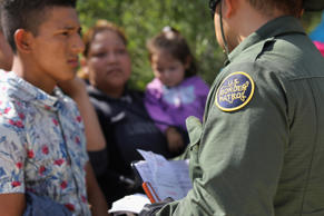 A U.S. Border Patrol agent takes a group of Central American asylum seekers into custody on June 12, 2018 near McAllen, Texas. The immigrant families were then sent to a U.S. Customs and Border Protection (CBP) processing center for possible separation. U.S. border authorities are executing the Trump administration's zero tolerance policy towards undocumented immigrants. U.S. Attorney General Jeff Sessions also said that domestic and gang violence in immigrants' country of origin would no longer qualify them for political-asylum status.