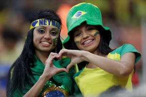Fans of Brazil join hands forming the figure of a heart prior to a 2018 World Cup qualifying soccer match between Brazil and Colombia in Manaus, Brazil, Tuesday Sept. 6, 2016.(AP Photo/Andre Penner)