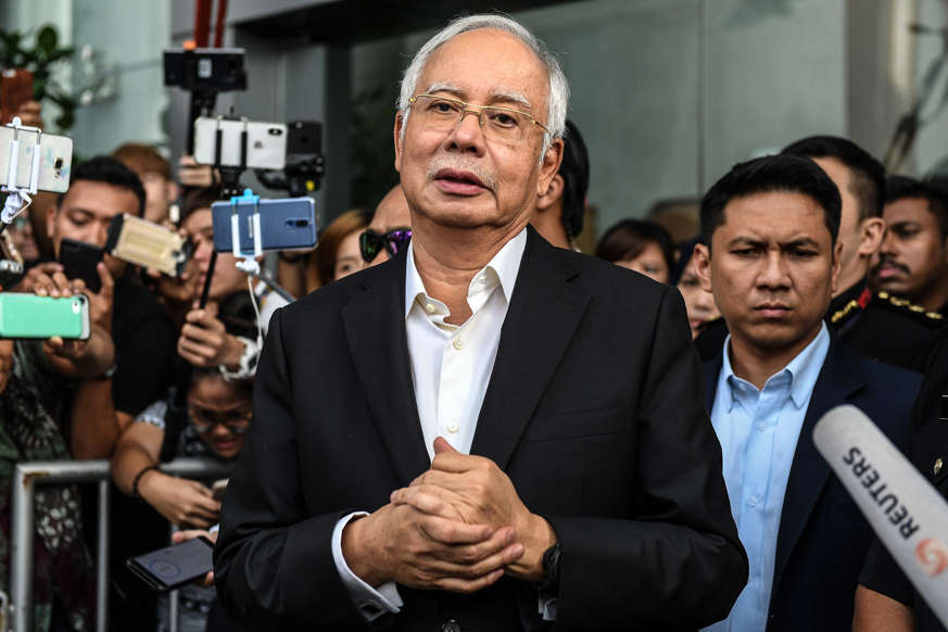 Slide 1 of 30: Malaysia's former prime minister Najib Razak speaks to the media after being questioned at the Malaysian Anti-Corruption Commission (MACC) office in Putrajaya on May 24, 2018. - Najib arrived at the anti-graft agency on May 24 to be questioned for a second time this week over a multi-billion-dollar corruption scandal following his shock election loss. (Photo by Mohd RASFAN / AFP)        (Photo credit should read MOHD RASFAN/AFP/Getty Images)
