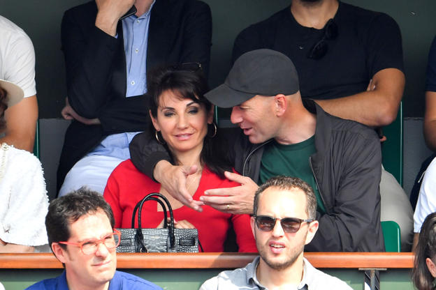 Slide 34 of 75: Zinedine Zidane and his wife Veronique attend the Men Final of the 2018 French Open - Day Fithteen at Roland Garros on June 10, 2018 in Paris, France.  (Photo by Stephane Cardinale - Corbis/Corbis via Getty Images)