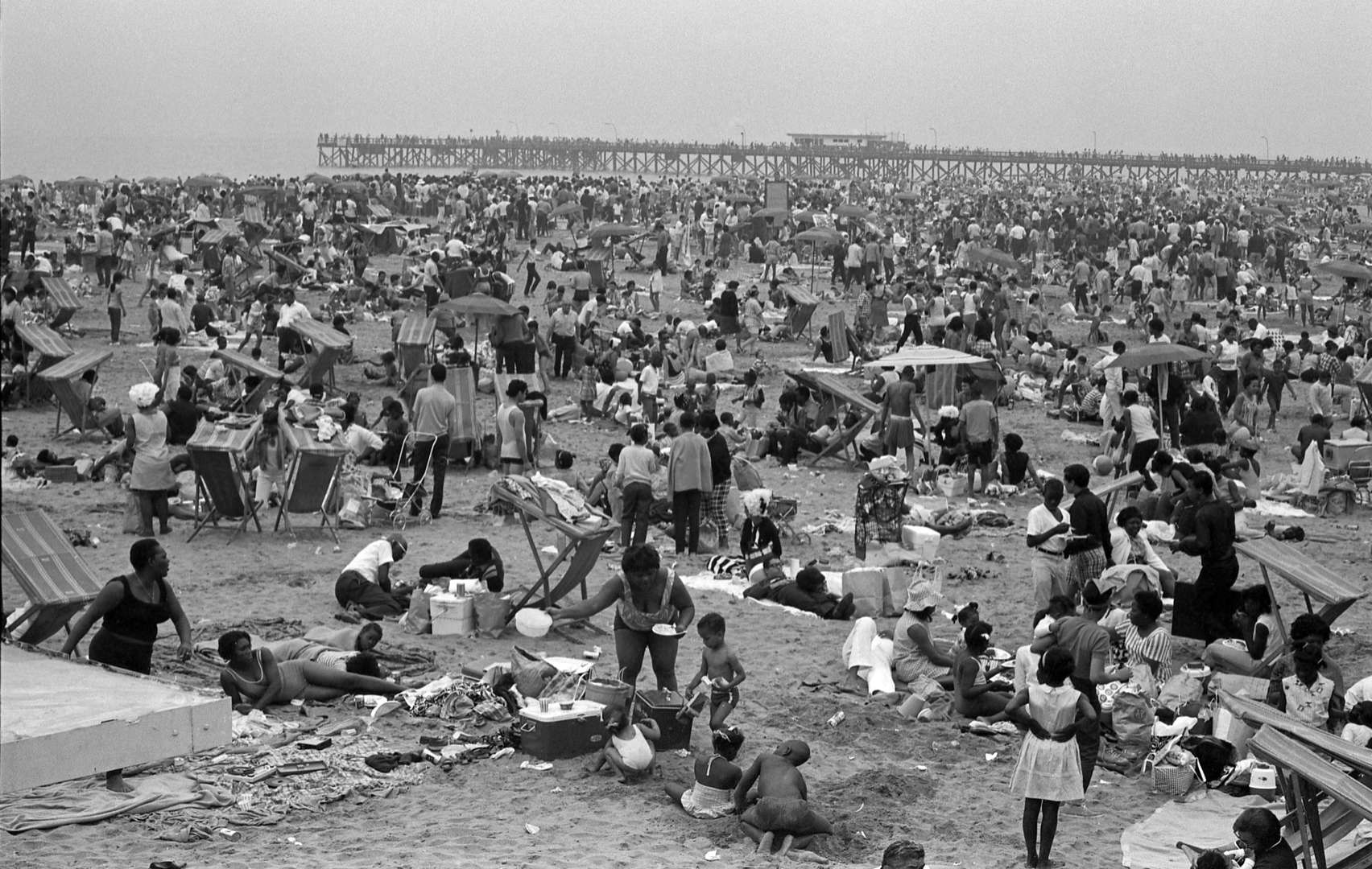 Slide 21 of 45: General view of the crowded Coney Island Beach, Brooklyn, New York, New York, July 4, 1968.