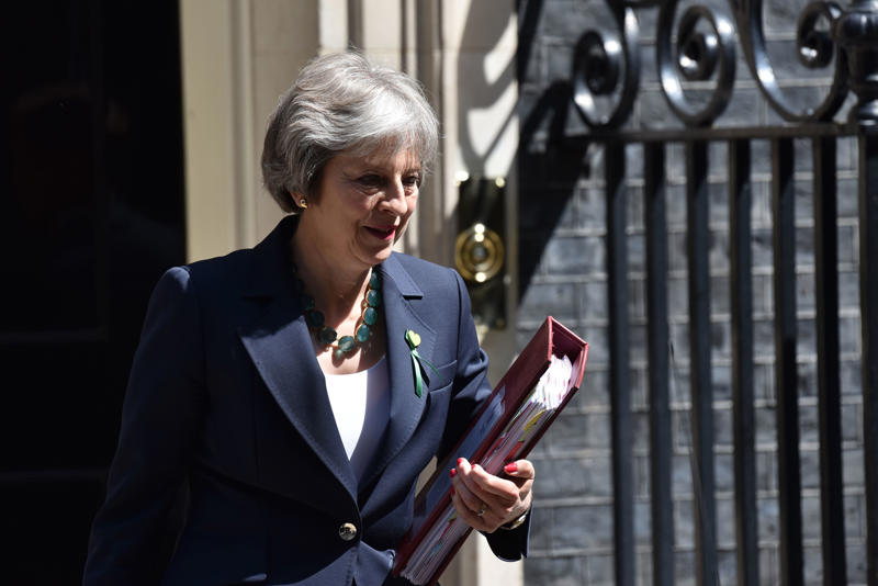 British Prime Minister Theresa May leaves Downing Street on June 13, 2018 in London, England. The Prime Minister will attend today the weekly Prime Ministers Questions in the House of Commons.  (Photo by Alberto Pezzali/NurPhoto via Getty Images)
