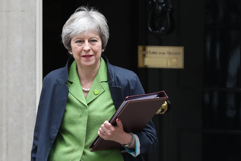 Britain's Prime Minister Theresa May leaves 10 Downing Street in central London on June 12, 2018. - MPs in the House of Commons will vote today on a string of amendments to a key piece of Brexit legislation that could force the government's hand in the negotiations with the European Union. (Photo by Daniel LEAL-OLIVAS / AFP)        (Photo credit should read DANIEL LEAL-OLIVAS/AFP/Getty Images)