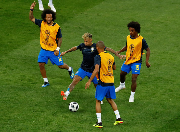 Soccer Football - World Cup - Group E - Brazil vs Switzerland - Rostov Arena, Rostov-on-Don, Russia - June 17, 2018   Brazil's Neymar, Marcelo and Willian warm up before the match   REUTERS/Jason Cairnduff