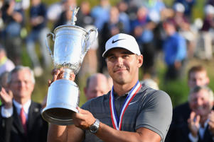 Brooks Koepka of the United States celebrates with the U.S. Open Championship trophy during the trophy presentation after winning the 2018 U.S. Open at Shinnecock Hills Golf Club on June 17, 2018 in Southampton, New York.