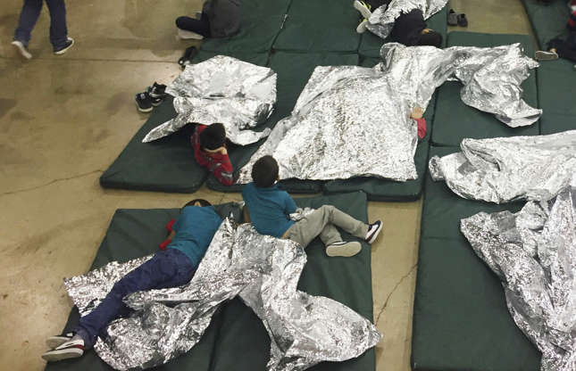 Slide 1 of 28: People who've been taken into custody related to cases of illegal entry into the United States, rest in one of the cages at a facility in McAllen, Texas, Sunday, June 17.