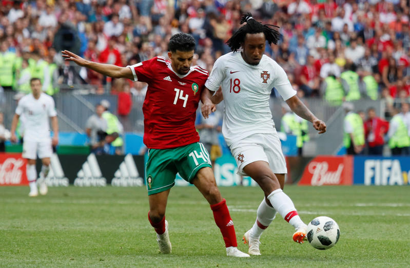 Soccer Football - World Cup - Group B - Portugal vs Morocco - Luzhniki Stadium, Moscow, Russia - June 20, 2018   Morocco's Mbark Boussoufa in action with Portugal's Gelson Martins     REUTERS/Maxim Shemetov