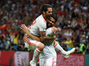 Spain's Diego Costa celebrates scoring their first goal with Isco.