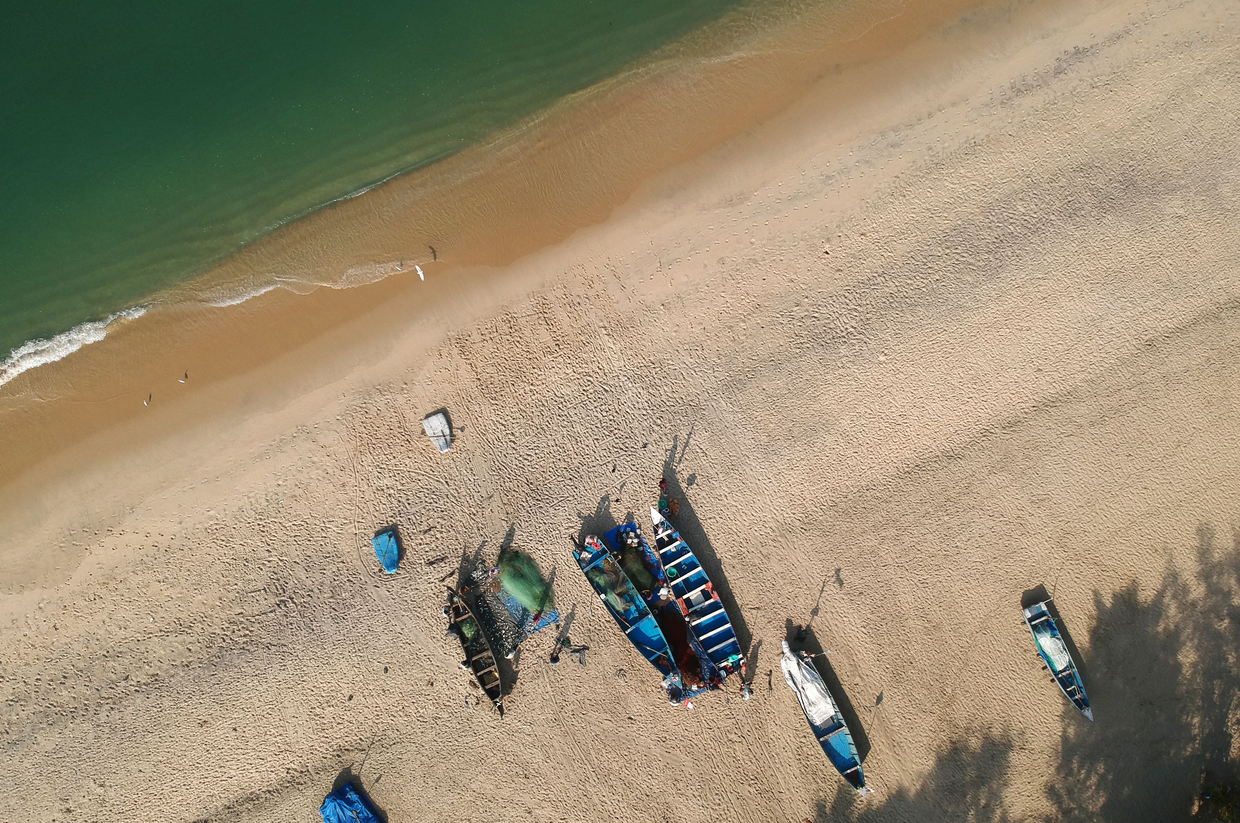 Slide 30 of 39: This photograph taken on January 11, 2018 shows an aerial view of Marari beach in the Indian state of Kerala.  / AFP PHOTO / DOMINIQUE FAGET        (Photo credit should read DOMINIQUE FAGET/AFP/Getty Images)