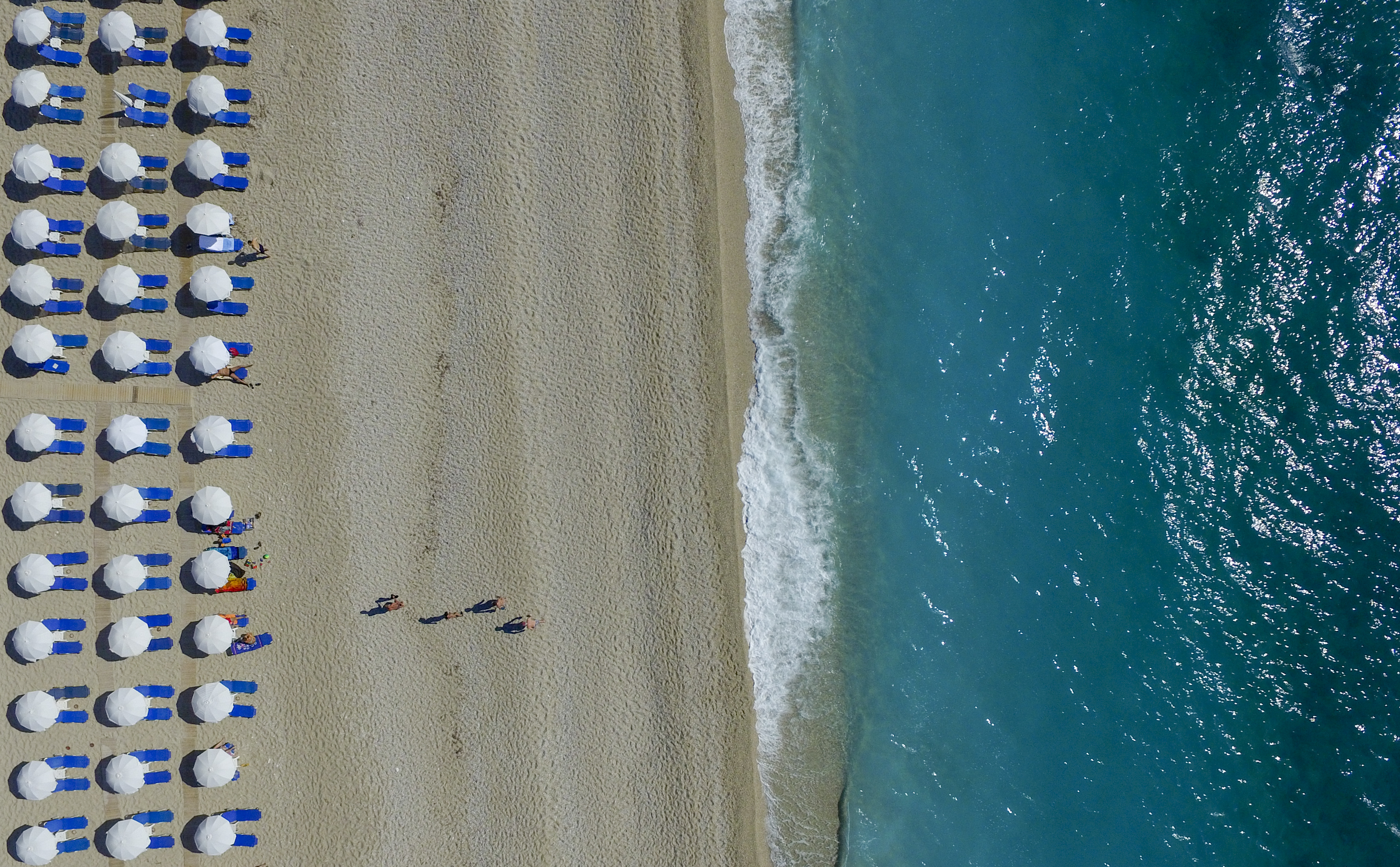 Slide 32 of 39: LEFKADA, GREECE - JUNE 08: Aerial view of umbrelas and people who enjoy the Kathisma beach on June 08, 2016 in Lefkada,Greece.  (Photo by Athanasios Gioumpasis/Getty Images)