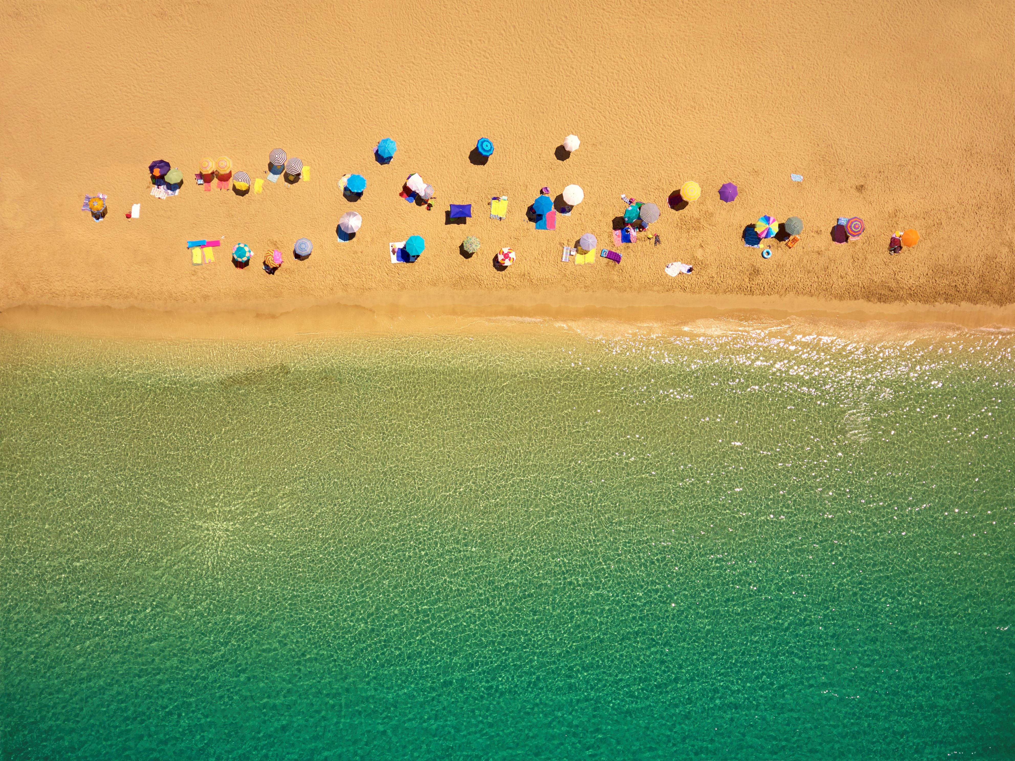 Slide 15 of 39: Drone photography of Platos Gialos beach with sun umbrellas viewed from above ; Lassi - Argostoli in Kefalonia island; Greece.