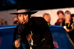 Actor Johnny Depp poses on a Cadillac before presenting his film The Libertine, at Cinemageddon at Worthy Farm in Somerset during the Glastonbury Festival in Britain, June 22, 2017