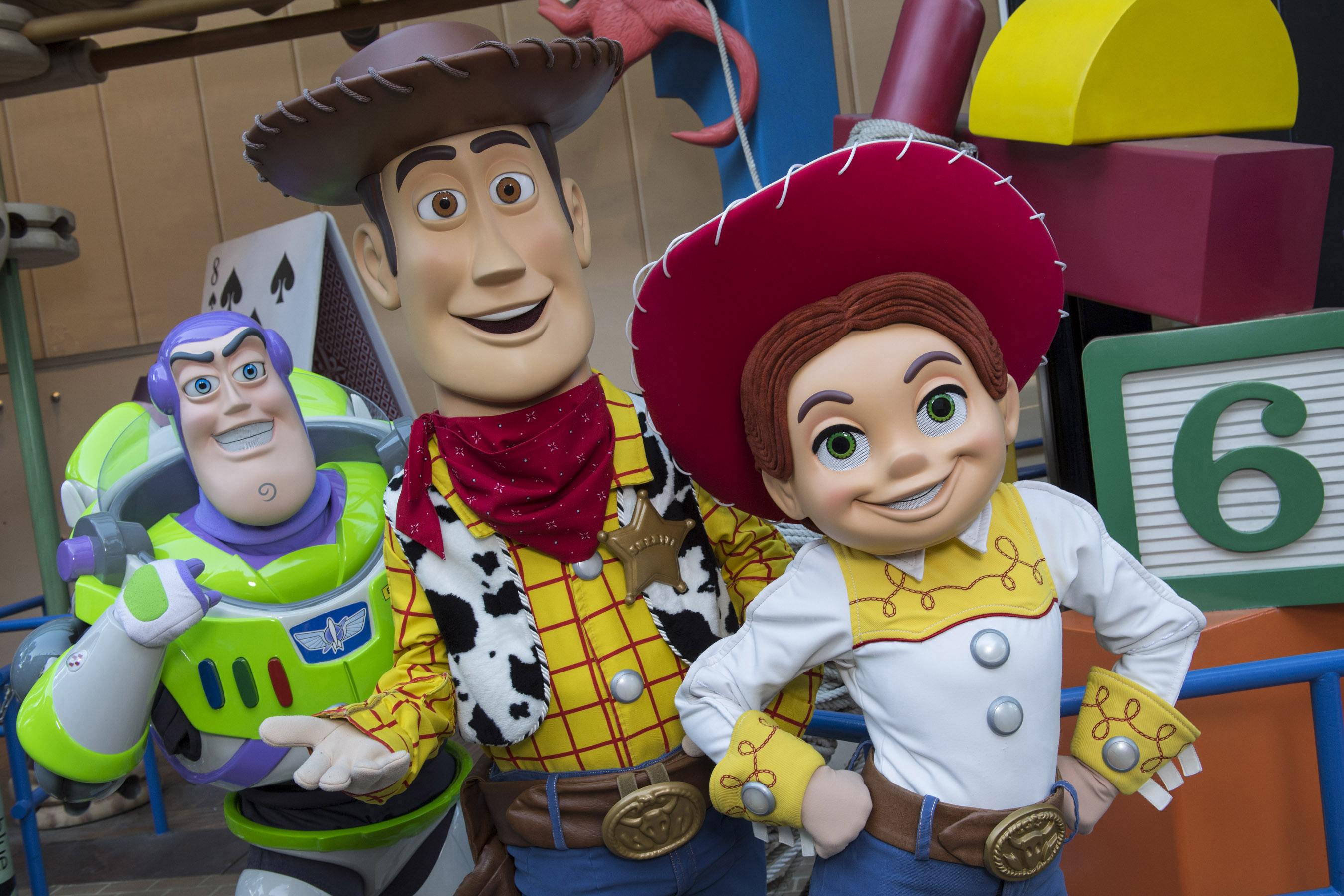"""Slide 1 of 15: BELOVED CHARACTERS COMING TO TOY STORY LAND AT WALT DISNEY WORLD RESORT (LAKE BUENA VISTA, Fla.) – Buzz Lightyear, Sheriff Woody and Jessie the Yodeling Cowgirl from Disney•Pixar's """"Toy Story"""" films will interact with guests in the new Toy Story Land when it opens June 30 at Disney's Hollywood Studios in Lake Buena Vista, Fla. This new 11-acre land will transport Walt Disney World guests into the adventurous outdoors of Andy's backyard where they will feel like they have shrunk to the size of a toy. (David Roark, photographer)"""