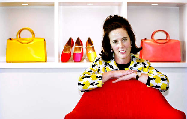 43608dd97ceb Kate Spade in a red shirt  Designer Kate Spade poses with handbags and  shoes from