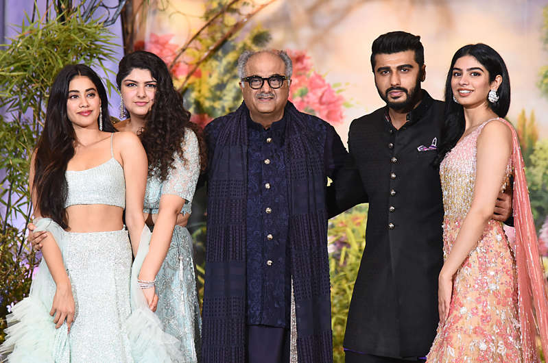 Boney Kapoor poses for a picture with his daughters Janhvi, Anshula and Khushi and son Arjun during the wedding reception of Sonam Kapoor