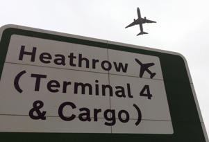 A plane takes off over a road sign near Heathrow Airport in London, Tuesday, June 5, 2018. (AP Photo/Kirsty Wigglesworth)