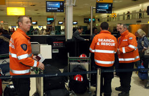 British search and rescue teams check-in at Heathrow Airport, where they are due to fly out to New Zealand to help in the search for missing people after the earthquake.   (Photo by Steve Parsons/PA Images via Getty Images)