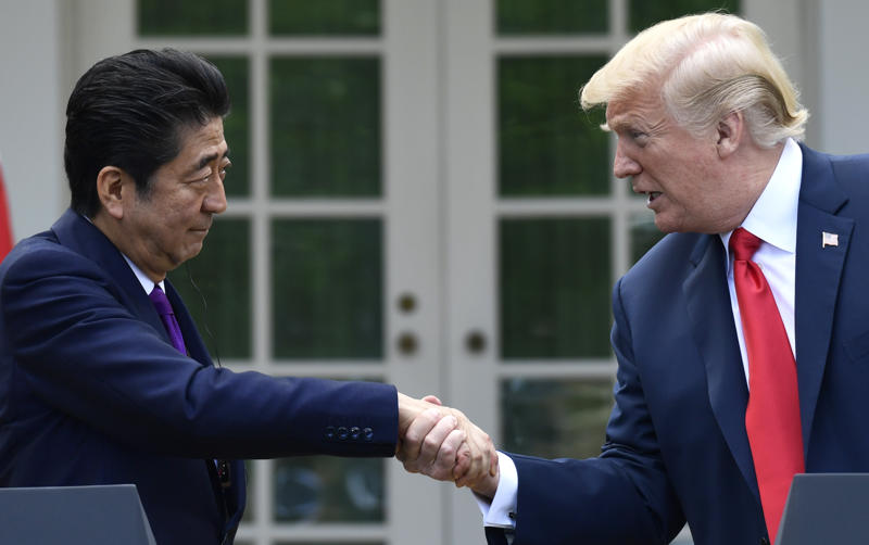 President Donald Trump, right, and Japanese Prime Minister Shinzo Abe, left, shake hands during a news conference in the Rose Garden of the White House in Washington, Thursday, June 7, 2018. (AP Photo/Susan Walsh)