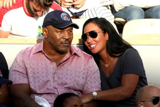Slide 48 of 75: Former Boxer Mike Tyson and his wife Lakiha Spicer are seen supporting Serena Williams during the 2018 French Open - Day Seven at Roland Garros on June 2, 2018 in Paris, France.  (Photo by Rindoff Petroff/Suu/Getty Images)