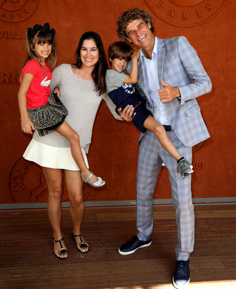 Slide 42 of 75: Tennis legend Gustavo Kuerten his wife Mariana,his son Luiz Felipe and his daughter Maria Augusta attend the 2018 French Open - Day Twelve at Roland Garros on June 7, 2018 in Paris, France.  (Photo by Rindoff Petroff/Suu/Getty Images)
