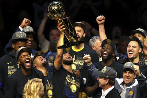 Stephen Curry (30) of the Warriors celebrates with the Larry O'Brien Trophy after defeating the Cavaliers during Game Four of the 2018 NBA Finals on June 8 in Cleveland, Ohio. The Warriors defeated the Cavaliers 108-85 to win the 2018 NBA Finals.