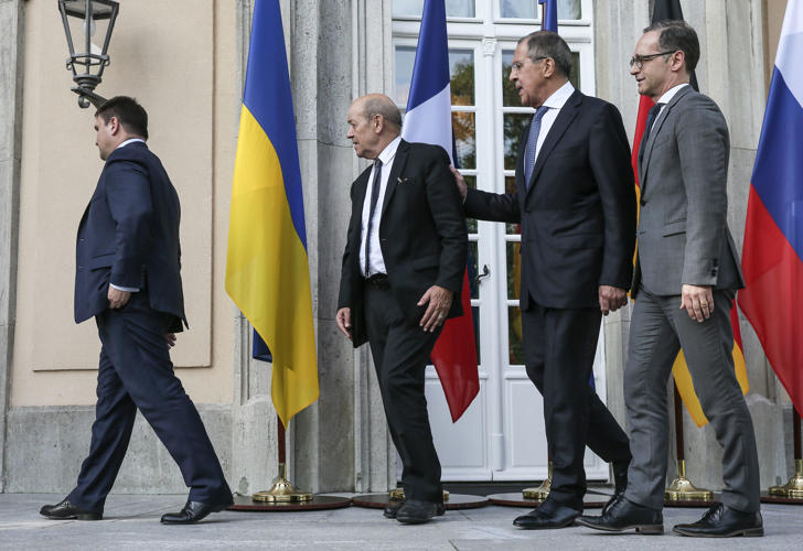 Ukraine's Minister of Foreign Affairs Pavlo Klimkin, France's Minister for Europe and Foreign Affairs Jean-Yves Le Drian, Russia's Minister of Foreign Affairs Sergei Lavrov, and Germany's Minister of Foreign Affairs Heiko Maas (L-R) at a meeting in the Normandy format to discuss the situation in Ukraine.