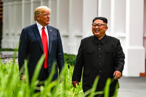 U.S. President Donald Trump and North Korea leader Kim Jong Un walk from their lunch at the Capella resort on Sentosa Island Tuesday, June 12, 2018 in Singapore.