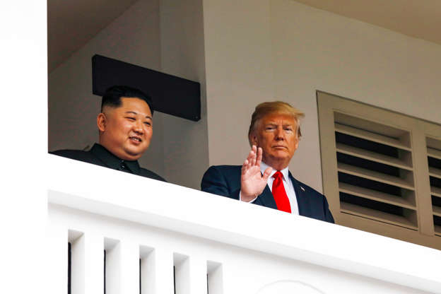 Slide 3 of 51: U.S. President Donald Trump and North Korea's leader Kim Jong Un hold a summit at the Capella Hotel on the resort island of Sentosa, Singapore June 12, 2018.