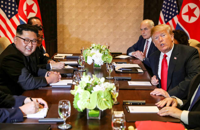 Slide 2 of 51: North Korea's leader Kim Jong Un is seen next to U.S. President Donald Trump before their expanded bilateral meeting at the Capella Hotel on Sentosa island in Singapore June 12, 2018.