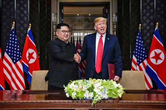 Slide 3 of 64: SINGAPORE, SINGAPORE - JUNE 12: In this handout photograph provided by The Strait Times, North Korean leader Kim Jong-un (L) with U.S. President Donald Trump (R) during their historic U.S.-DPRK summit at the Capella Hotel on Sentosa island on June 12, 2018 in Singapore. U.S. President Trump and North Korean leader Kim Jong-un held the historic meeting between leaders of both countries on Tuesday morning in Singapore, carrying hopes to end decades of hostility and the threat of North Korea's nuclear programme.