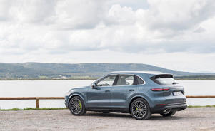 a car parked in front of a body of water: We've Got Porsche PHEV-er: New Cayenne E-Hybrid Driven