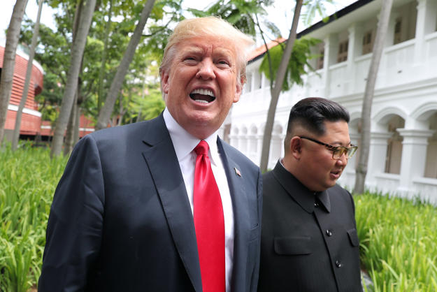 U.S. President Donald Trump and North Korean leader Kim Jong Un walk after lunch at the Capella Hotel on Sentosa island in Singapore June 12, 2018. REUTERS/Jonathan Ernst