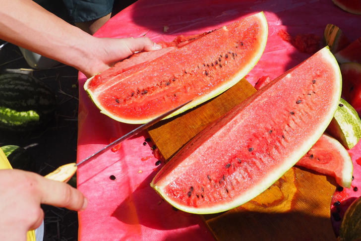 Slicing a watermelon at a watermelon festival